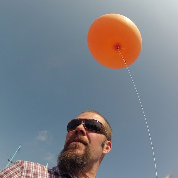 Sean McGinnis, with one of the balloons he uses for mapping.